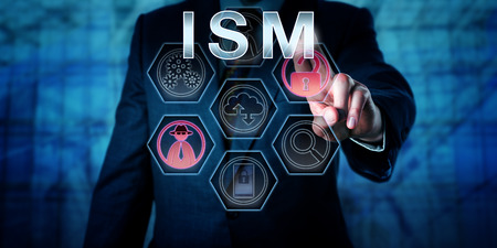 Male computer security specialist is touching ISM on an interactive virtual control screen. Business risk metaphor and security concept for information security management and data asset protection.