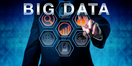 technology transaction: Male corporate manager is pushing BIG DATA on an interactive virtual touch screen interface. Business metaphor involving data management, technology forecasting and transaction processing.