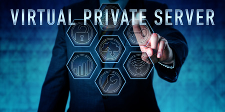 private server: Administrator pressing VIRTUAL PRIVATE SERVER on an interactive control monitor. Business metaphor and computer network security concept for a virtual machine licensed from a hosting service. Stock Photo