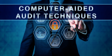auditor: Auditor is pushing COMPUTER-AIDED AUDIT TECHNIQUES on a virtual interactive control monitor. Business risk metaphor. Concept for information technology audit, data analysis software and simply CAATs.