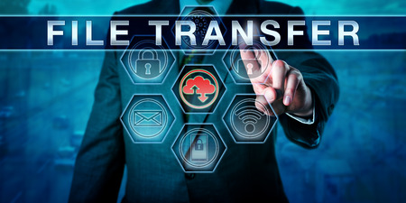 endpoint: Corporate client is touching FILE TRANSFER on an interactive virtual  control monitor., internet terminology, business metaphor and information technology concept for secure network data transfer. Stock Photo