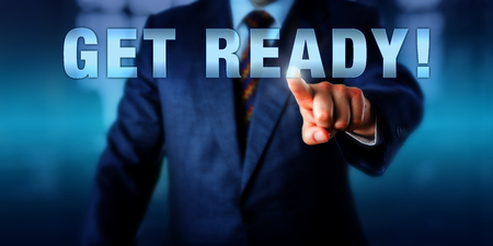 get ready: Corporate coach is touching GET READY! on a virtual interactive display. Motivational appeal, call to action and business concept for preparation in anticipation of future events.