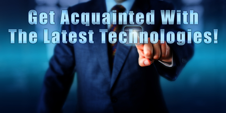 acquaint: Manager pushing the sentence Get Acquainted With The Latest Technologies! onscreen in mid air. Business concept, motivational metaphor and call to action. Close up torso shot of a man in blue suit.