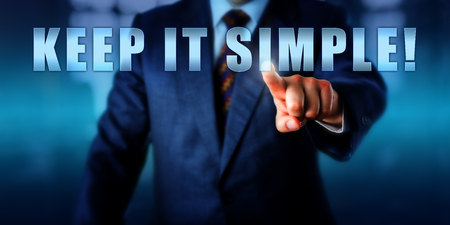Business coach is pressing KEEP IT SIMPLE! on a virtual touch screen interface. Call to action, motivational appeal and business concept for a straight-forward tactical approach to management.