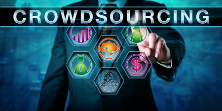 contributors: Male entrepreneur is touching CROWDSOURCING on an interactive control screen. Concept for the process of outsourcing business needs to an online crowd of contributors and part-time workers. Stock Photo