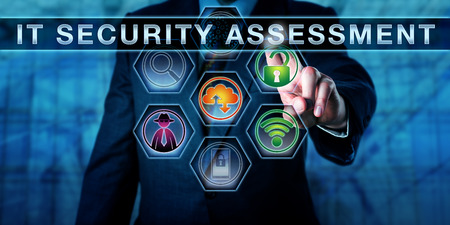 auditor: Male corporate auditor pushing IT Security Assessment on a virtual control screen. Information technology concept for computer security auditing process and security management. Close up torso shot. Stock Photo