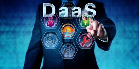 Male software developer is pushing DaaS on an interactive touch screen. Business concept. Information technology metaphor for Desktop as a Service, user virtualization and disaster recovery strategy.