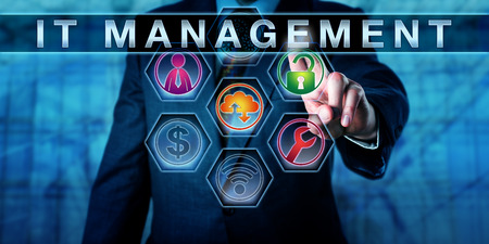 Business executive is touching IT MANAGEMENT on an interactive virtual screen. Business metaphor for Information Technology Management, involving IT governance, IT service and financial management. Standard-Bild