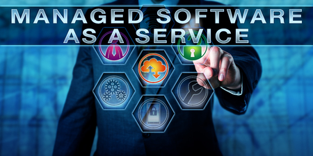 technology metaphor: Manager is touching MANAGED SOFTWARE AS A SERVICE on an interactive control screen. Business concept for MSaaS and information technology metaphor for packaged IT solutions.
