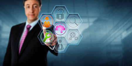 virtualization: Business man touching managed service tool icons on a virtual screen. Business metaphor and internet concept for services management, outsourcing, data backup, virtualization and technical support.