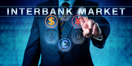 interbank: Investor is pressing INTERBANK MARKET on an interactive touch screen. Business metaphor and central banking concept for forex or foreign exchange market. Dollar, pound and yuan or yen lighting up.