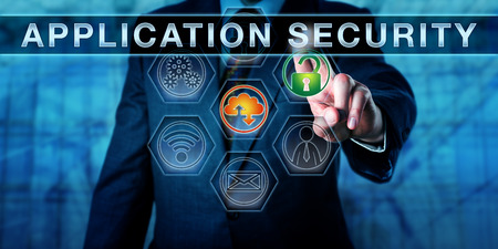 security gap: Businessman is pushing APPLICATION SECURITY on an interactive control screen. Computer security and information technology concept. Business metaphor. Close up torso shot of manager in blue suit.
