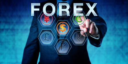 interbank: Interbank trader touching FOREX on an interactive control monitor. Business concept currency conversion and acronym for Foreign Exchange Market. Metaphor for monetary management. Close up torso shot.