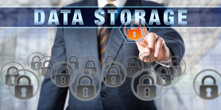mass storage: Male corporate database manager pressing DATA STORAGE on an interactive control screen. Business metaphor. Information technology concept for computer storage, data security and mass storage media.