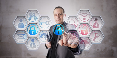 crime prevention: Happy information security professional is closing a lock to secure data via touch. Unprotected computer network remains red. Business concept for data security, computer security, crime prevention. Stock Photo