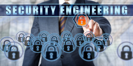 crime prevention: Torso of manager in steel blue business suit is touching SECURITY ENGINEERING on a transparent interface. Business metaphor and information technology concept for crime prevention and cryptography.
