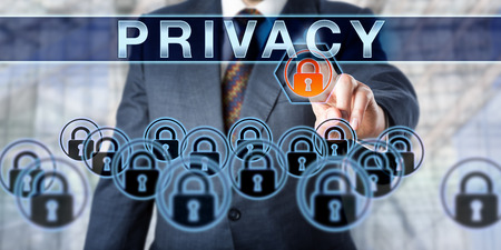 identity management: Business manager is pushing PRIVACY on an interactive touch screen monitor. Information technology concept for data security, identity management, access control, digital rights and privacy. Stock Photo