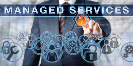 providers: Corporate manager pushing MANAGED SERVICES on an interactive virtual screen. Business metaphor and information technology concept for outsourcing network security as part of enterprise IT strategy.