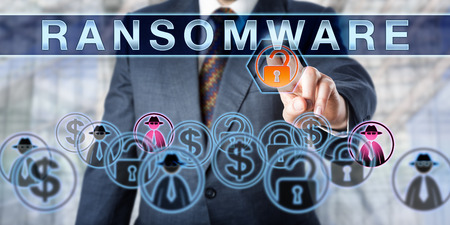 ransom: Corporate manager is touching RANSOMWARE on an interactive control screen. Information security concept for the crime of extorting ransom money via computer malware causing a access restrictions.