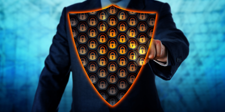 Businessman activating a virtual antivirus shield covering his chest. Cybersecurity metaphor and information technology concept for a virtual firewall, network defense and virus removal. Copy space.