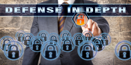 technology metaphor: Manager is pressing DEFENSE IN DEPTH on a virtual control screen. Information assurance concept and technology metaphor for a computer network defense strategy using multiple layers of security. Stock Photo