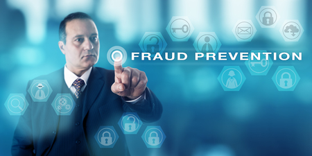 crime prevention: Experienced forensic investigator with a stern look pressing a virtual push button that activates the term FRAUD PREVENTION. Computer and civil crime metaphor, law enforcement and business concept. Stock Photo