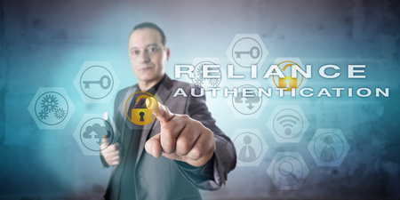 attribution: Corporate information security manager with confident face is activating the phrase RELIANCE AUTHENTICATION onscreen. Information technology concept for a multi-factor identity allocation process.