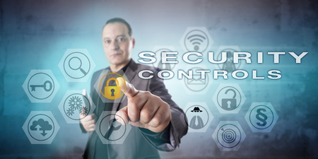 counteract: Information systems manager with confident and determined look in his face is operating SECURITY CONTROLS onscreen. Concept for computer network security, data security and security procedures.
