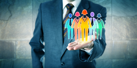 White collar manager presenting a work team of five multicolored worker icons in open palm of his left hand. Business concept for team building, diversity inclusion culture and staffing solutions.