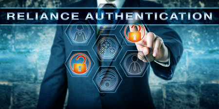 attribution: Security manager is activating the phrase RELIANCE AUTHENTICATION on a touch screen. Information technology concept for a multi-factor authentication process or trust-based identity allocation. Stock Photo