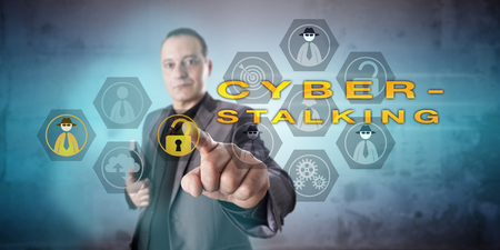 Crime investigator is looking into a CYBERSTALKING scenario. Kind, but intent and preoccupied facial expression. Resolute and energetic touch with finger. Concept for cybercrime and criminal offense. Stock Photo