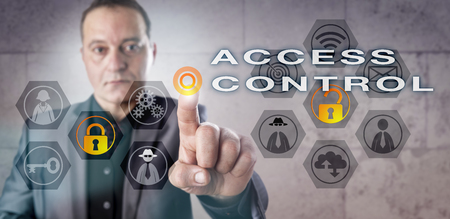 identity management: Male corporate administrator activating ACCESS CONTROL onscreen. Information technology metaphor involving identity management, computer security, selective restriction of access and authorization.