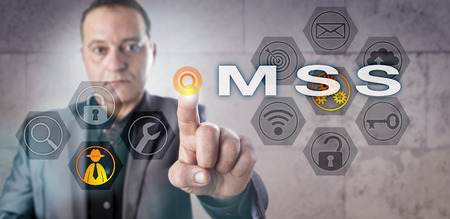 Experienced security services provider is pressing MSS onscreen. Business metaphor and information technology concept for Managed Security Services or computer network security via outsourcing.