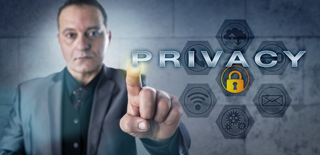 identity management: Determined mature businessman touching PRIVACY on an interactive screen. Information security concept for data privacy, identity management, digital rights and confidentiality of electronic contents. Stock Photo