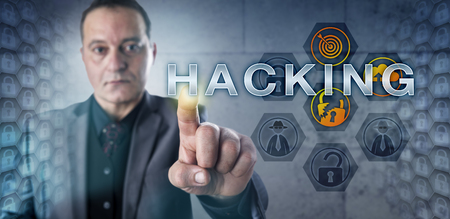 technology metaphor: Mature male corporate security expert touching HACKING onscreen. Information technology metaphor for the activity of identifying network vulnerabilities and exploiting computer security weaknesses.