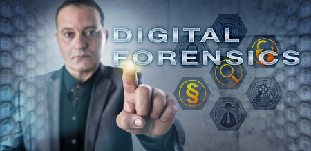 technology metaphor: Mature male forensic investigator is pressing DIGITAL FORENSICS onscreen. Information technology metaphor and law enforcement concept for the forensic discipline of investigating digital media. Stock Photo