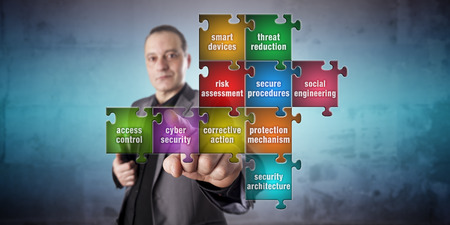 crime prevention: Corporate IT manager with calm facial expression is touching a jigsaw piece labeled cyber security in an incomplete computer security puzzle. Information technology and crime prevention concept.