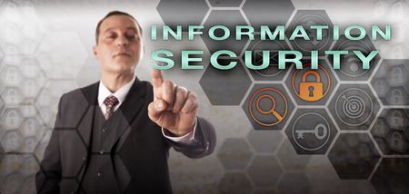 crime prevention: Self-assured male cyberspace inspector pressing INFORMATION SECURITY onscreen. Information technology concept for InfoSec, computer security, data security, crime prevention and cryptography.