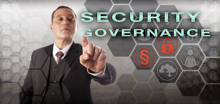 corporate governance: Confident male business manager is touching SECURITY GOVERNANCE onscreen. Information technology metaphor and business concept for the enforcement of an enterprise computer security policy. Stock Photo
