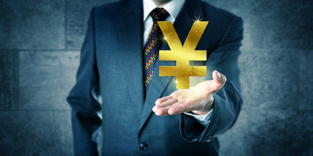interbank: Financial trader offering a golden China yuan or Japanese yen sign in the upward facing open palm of his left hand. Business concept for trade, exchange, currency, investment and interbank market. Stock Photo