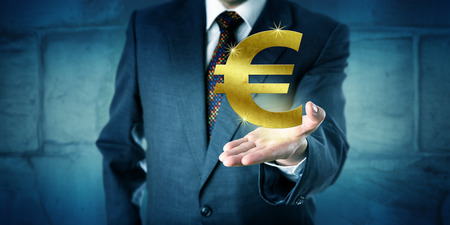 interbank: Currency trader showing a virtual golden Euro symbol hovering above the open palm of his raised left hand. Business concept and financial metaphor for interbank market, forex, wealth and investment. Stock Photo