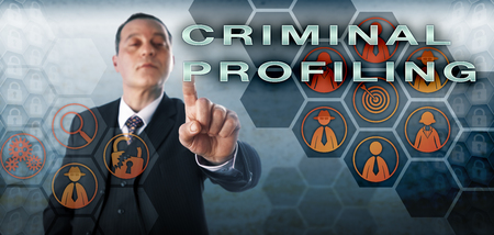 investigative: Computer forensic investigator is touching CRIMINAL PROFILING on an interactive screen. Information technology concept and law enforcement metaphor for offender profiling and criminal investigation. Stock Photo