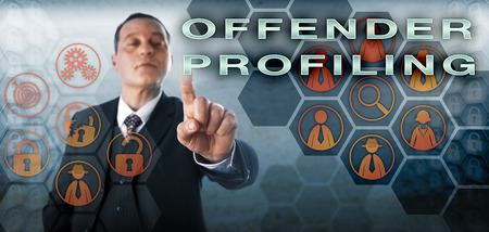 profiling: Mature criminal investigator pushing OFFENDER PROFILING on an interactive screen. Business metaphor and law enforcement concept for electronic evidence collection and digital forensic investigation.