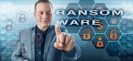 extortion: Happy smiling business computer user is touching RANSOMWARE on a control screen. Information technology concept for access restricting malware linked to extortion of ransom money to regain access.
