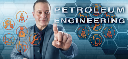 Smiling industrial manager touching PETROLEUM ENGINEERING on a screen. Engineering discipline concept and petroleum industry metaphor for engineering work relating to crude oil and natural gas.