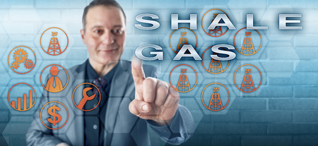 Cheerful industrial manager with toothless smile pushing SHALE GAS on an interactive control screen. Fossil fuel metaphor and energy industry concept for natural gas production from shale formations.