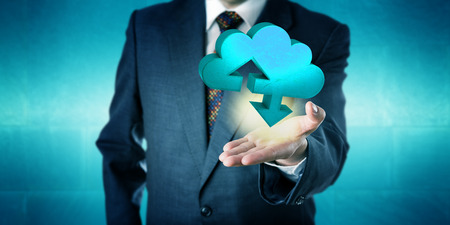 tangible: Businessman holding a tangible three-dimensional cloud transfer symbol in the upward facing open palm of his left hand. Computing concept for cloud storage services, mobile data upload and download. Stock Photo