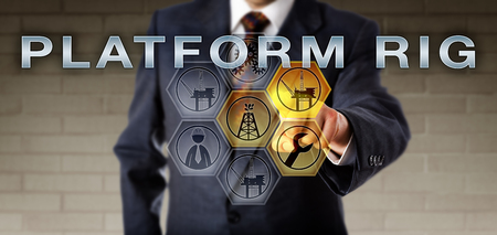 Male corporate executive is touching PLATFORM RIG on an interactive control screen highlighting virtual symbols. Oil and gas offshore drilling rig metaphor and field development management concept.