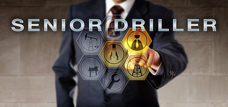 supervisory: Industrial manager touching SENIOR DRILLER on a virtual control screen. Oil and gas industry career metaphor for a mature supervisory position coordinating the use of drill and rotating equipment. Stock Photo