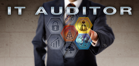 Recruitment agent in blue business suit activating IT AUDITOR on an interactive virtual control screen. Information technology job concept relating to planning of audits in the oil and gas industry. Stock Photo